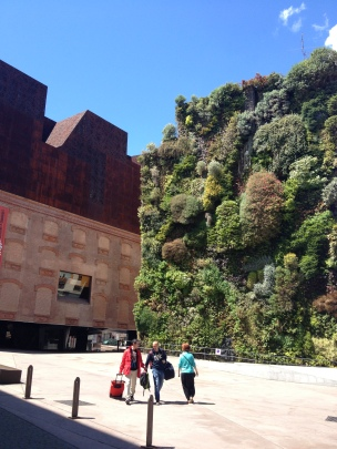 Caixa Museum with live plants growing on the side of its walls